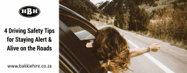 a girl driving with her head and arm out the window