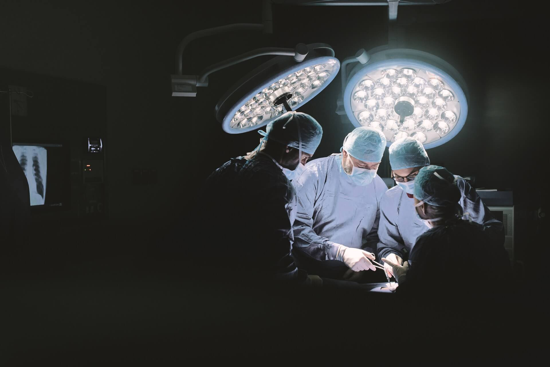 Surgeons operating in theater