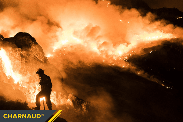 Firefighter on fire-filled mountain