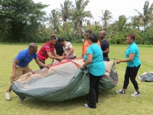 People building a tent