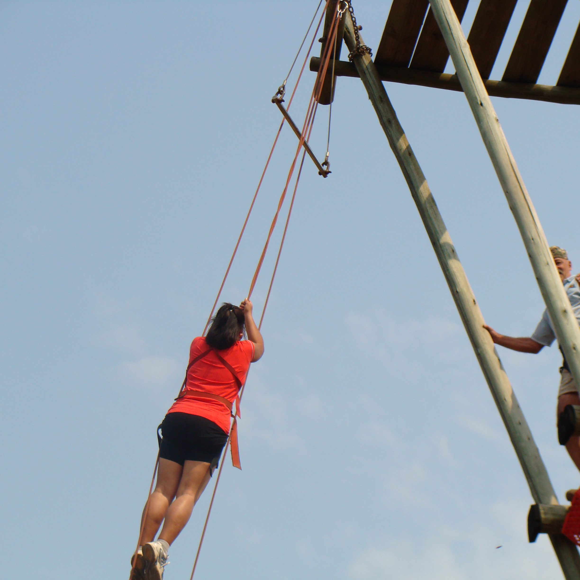Woman hanging on harness