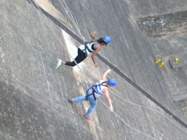 People abseiling