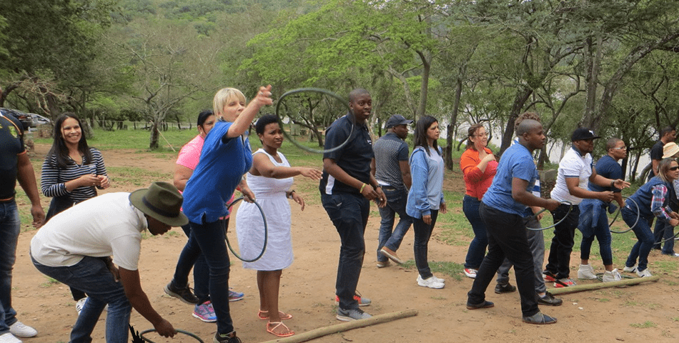 Team throwing hoops and doing a successful teambuilding activity